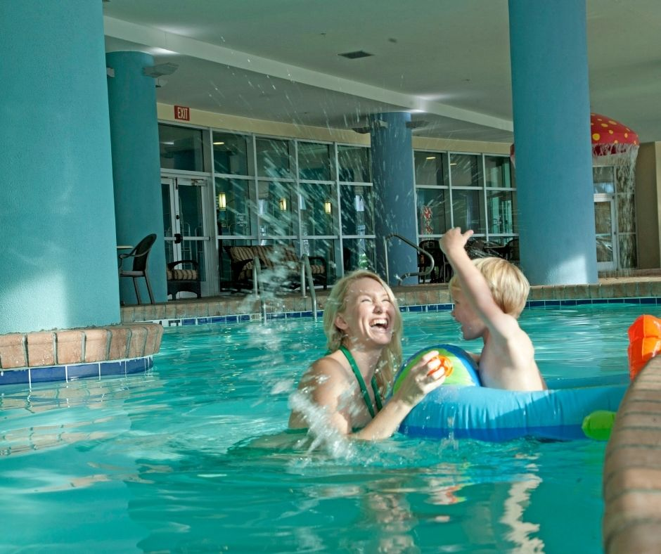 Mom and Son Playing in Indoor Pool at Bay View Resort