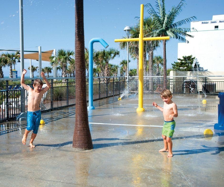Two Kids Playing at Bay View Resort's Outdoor Splash Deck