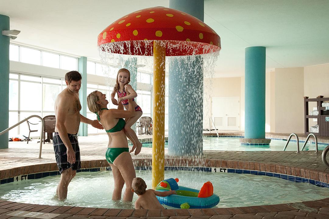 Kiddie pool with waterfall mushroom