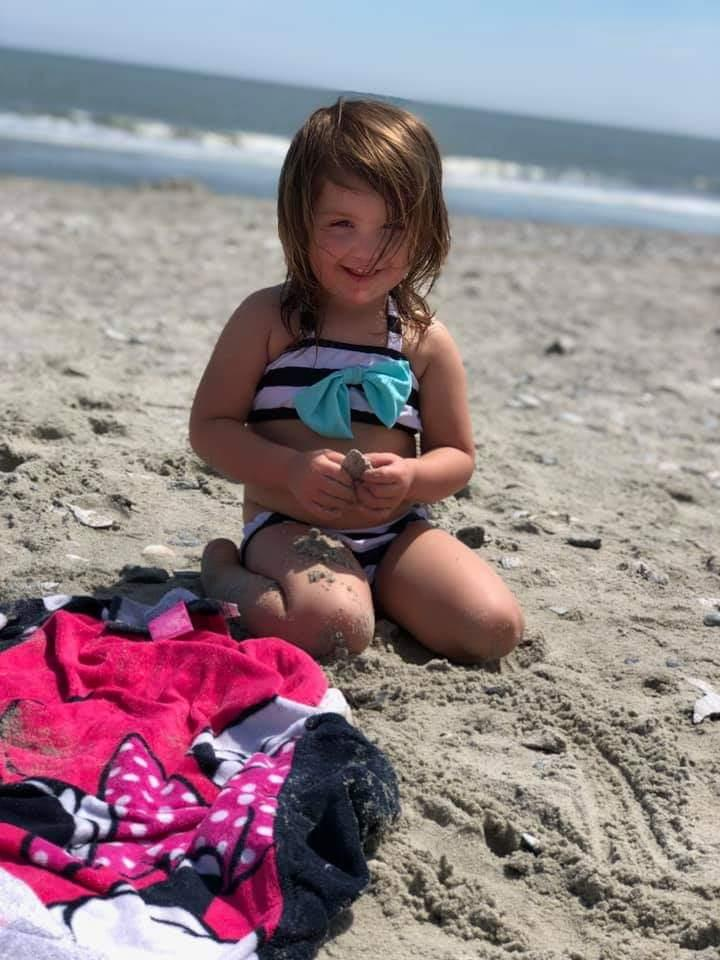 Little Girl Sitting in the Sand
